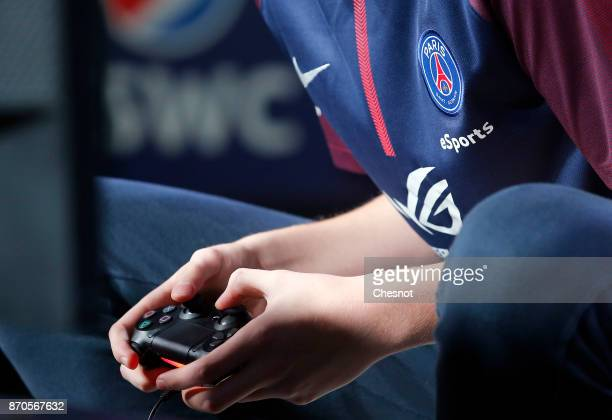French player E-Sports, Lucas Cuillerier, gamertag 'DaXe' of the eSports team of Paris Saint-Germain uses a video game controller as he competes in...