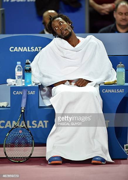 French player Gael Monfils rests during his tennis match against Belgian player Steve Darcis at the Open Sud de France world tour ATP on February 6,...
