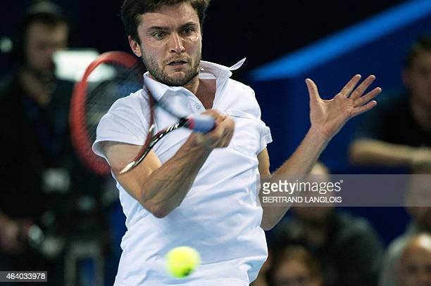 French player Gilles Simon returns a ball to Ukrainian player Sergiy Stakhovsky during the Open 13 semi-final tennis match in Marseille, southern...
