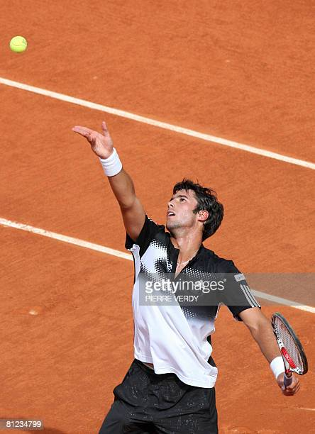 French player Jonathan Eysseric serves to British player Andy Murray during the first round of the French Tennis Open at Roland Garros in Paris on...