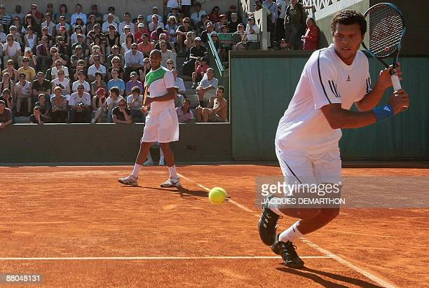 French player Josselin Ouanna and French player JoWilfried Tsonga play against India's Mahesh Bhupati and Bahama's