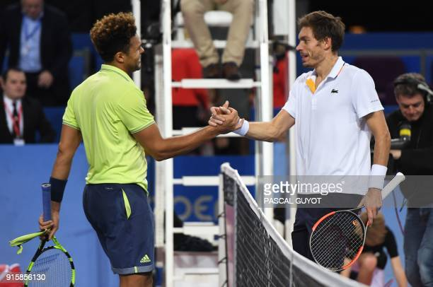 French player JoWilfried Tsonga shakes hands with French player Nicolas Mahut after their Open Sud de France ATP World Tour tennis match in...