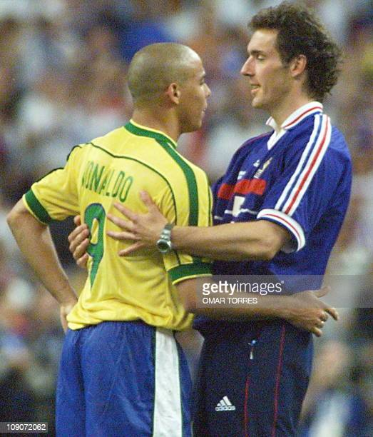 French player Laurent Blanc congratulates Brazilian striker Ronaldo 12 July at the Stade de France in SaintDenis near Paris after host France beat...