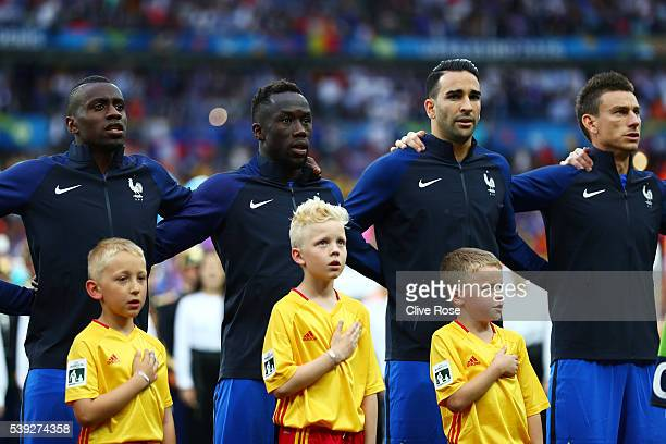 French player line up for the national anthem prior to the UEFA Euro 2016 Group A match between France and Romania at Stade de France on June 10 2016...