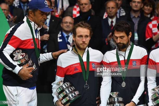 French player Lucas Pouille reacts after the Davis Cup World Group final against Croatia's Marin Cillis at The Pierre Mauroy Stadium in...