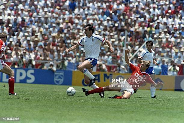 French player Maxime Bossis fights for the ball against his Soviet opponent during the World Cup football match between France and Soviet Union on...