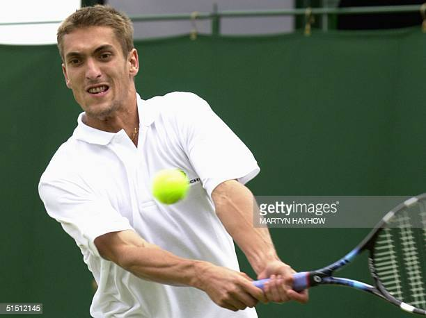 French player Nicolas Escude takes aim for a backhand during his second round match against Leander Paes of India at the All England Tennis...