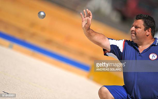 French player Philippe Quintais competes against Italian team during the Pentaquemen's double final at the 2009 XVI Mediterranean Games in Pescara on...