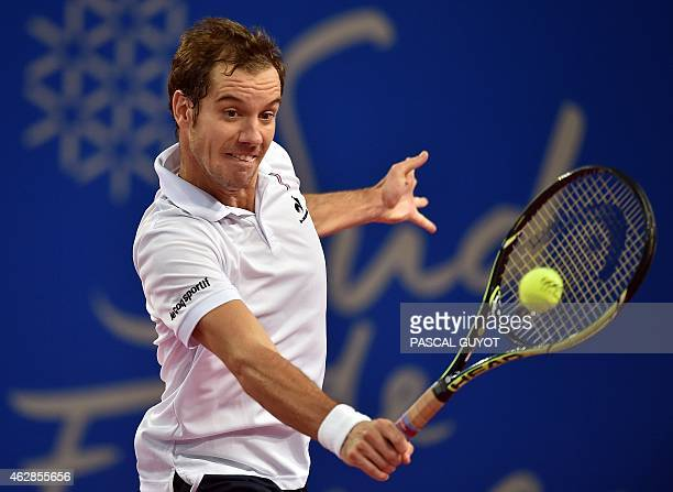 French player Richard Gasquet returns the ball to Uzbek player Denis Istomin during their tennis match at the Open Sud de France world tour ATP on...