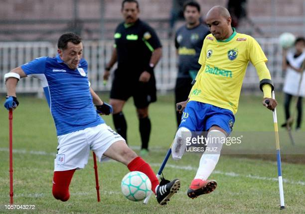 French player Tristam Diaz vies for the ball with William Machado of Brazil during their 2018 Amputee Football World Cup match in San Juan de los...
