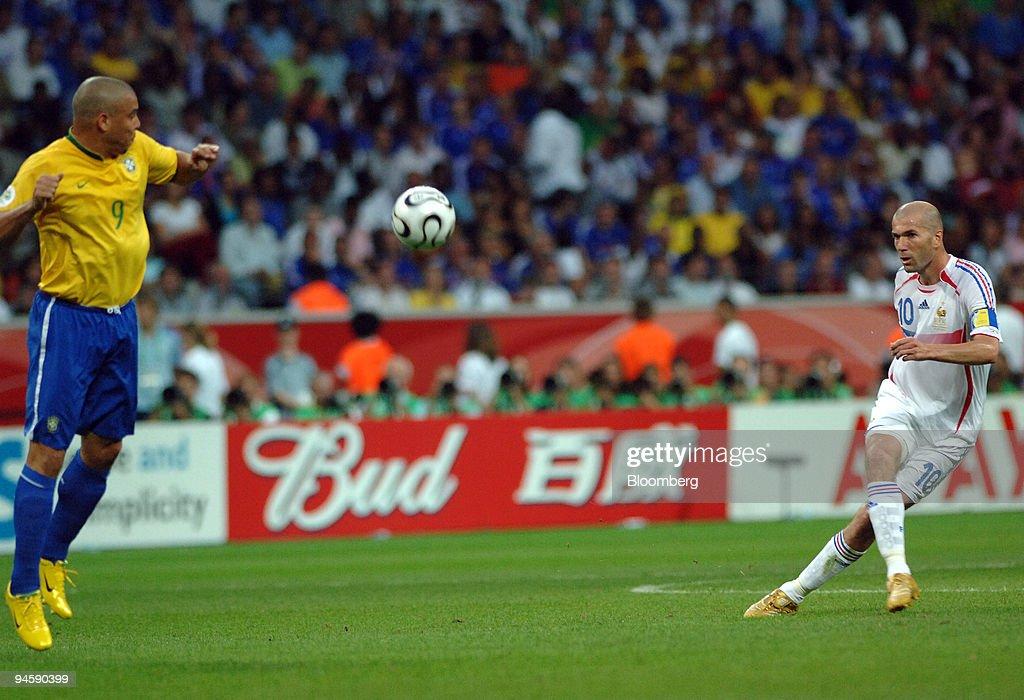 French player Zinedine Zidane, right kicks the ball as Brazi : News Photo