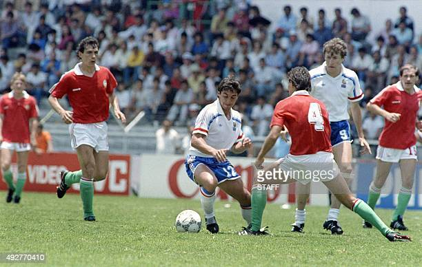French players Alain Giresse drives the ball past Hungarian opponents during the World Cup first round soccer match between France and Hungary 09...
