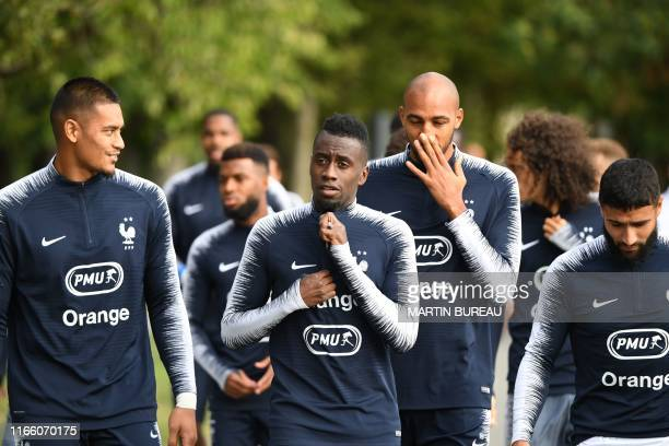 French players Alphonse Areola Blaise Matuidi Steven Nzonzi and Nabil Fekir arrive to attend a training session in Clairefontaine on September 5 2019