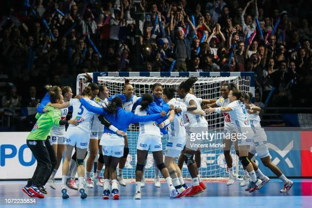 French players celebrate at the end of the match after defeating Serbia during the EHF Euro match between Serbia and France on December 12 2018 in...