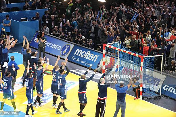 French players celebrate the victory with the fan during the 25th IHF Men's World Championship 2017 Semi Final match between France and Slovenia at...