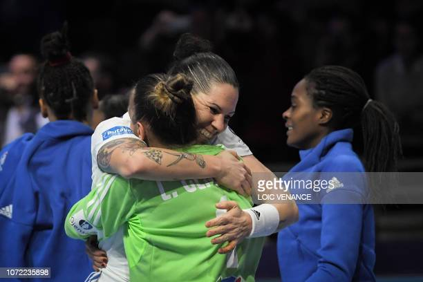 French players celebrate their victory after the Women Euro 2018 handball Championships Group 1 main round match between Serbia and France, at the...