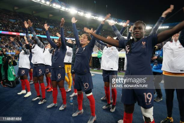 French players celebrate their victory at the end of the France 2019 Women's World Cup Group A football match between France and South Korea, on June...
