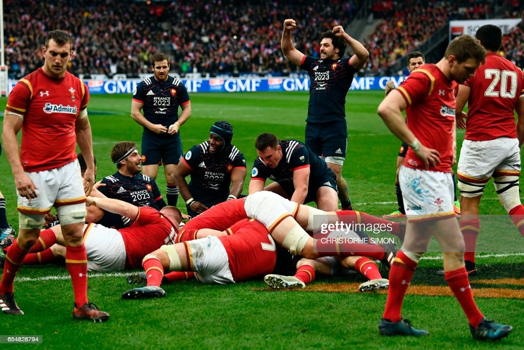 TOPSHOT - French players celebrate their victory at the end of the Six Nations tournament Rugby Union match between France and Wales at the Stade de France in Saint-Denis, outside Paris, on March 18, 2017. /