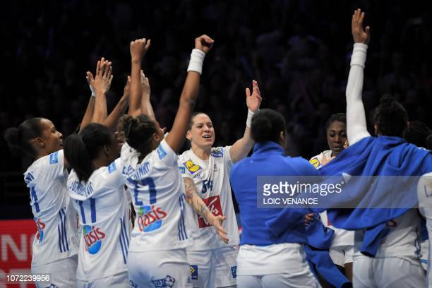 French players celebrate their victory during the Women Euro 2018 handball Championships Group 1 main round match between Serbia and France, at the...