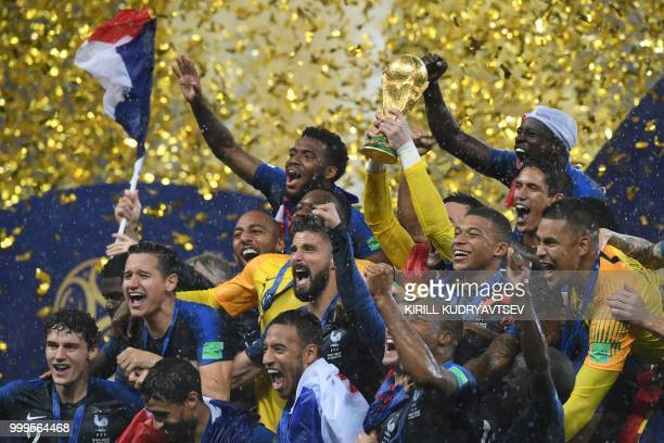 TOPSHOT French players celebrate with the trophy at the end of the Russia 2018 World Cup final football match between France and Croatia at the...