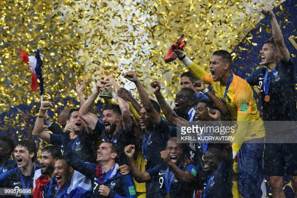 French players celebrate with the trophy at the end of the Russia 2018 World Cup final football match between France and Croatia at the Luzhniki...