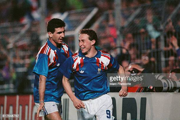 French players Eric Cantona and JeanPierre Papin celebrate scoring a goal for their team during a friendly match against Germany France won 21