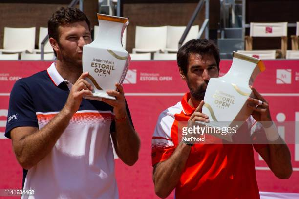 French players Jeremy Chardy and Fabrice Martin kiss the trophy after their won against British's players Jonny O'Mara and Luke Bambridge the...