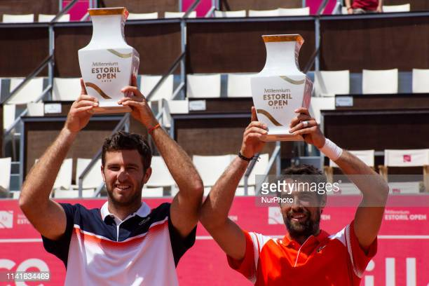 French players Jeremy Chardy and Fabrice Martin pose with the trophy after their won against British's players Jonny O'Mara and Luke Bambridge the...