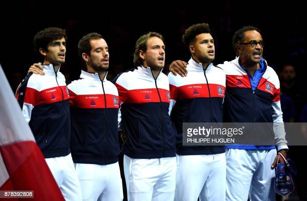 French players PierreHugues Herbert Richard Gasquet Lucas Pouille JoWilfried Tsonga and France's captain Yannick Noah sing the national anthem prior...