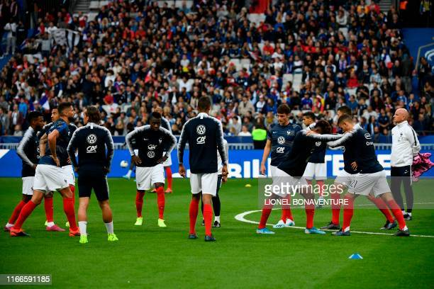 French players warm up prior to the UEFA Euro 2020 qualifying Group H football match between France and Albania at the Stade de France stadium in...