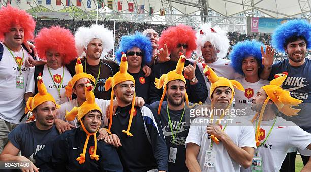 French players wearing France's national colors and roosters on their heads pose during the Hong Kong Rugby Sevens tournament on March 30 2008 The...