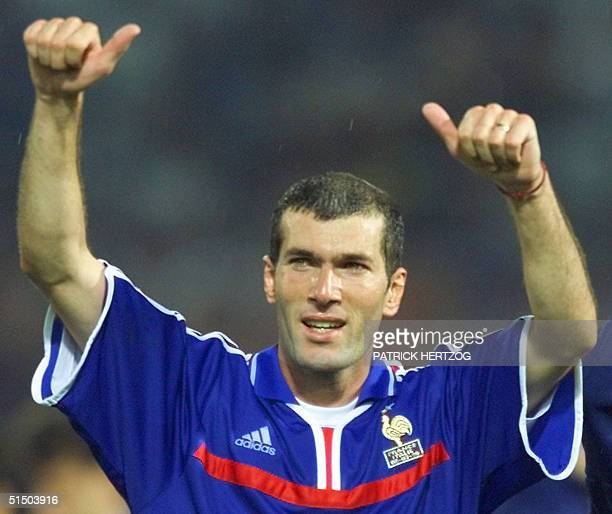 French playmaker Zinedine Zidane celebrates at the end of the Euro-2000 soccer championships after France won the final against Italy, 2-1, at...