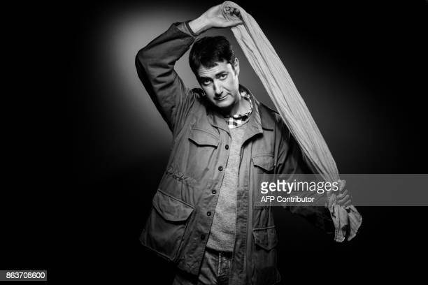 French playwright and author Alexis Ragougneau poses during a photo session in Paris on October 20 2017 / AFP PHOTO / JOEL SAGET