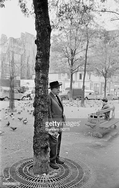 French poet Jacques Prévert walking down the streets of Paris France circa 1960