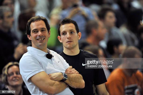 French pole vault champion Renaud Lavillenie is pictured with his coach Damien Inocercio during the French Indoor Athletic Championships in Aubiere...