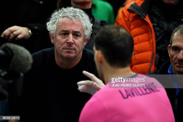 French pole vaulter Renaud Lavillenie speaks with his coach Philippe D'Encausse during the Tignes Open Indoor athletics meeting in Tignes on January...