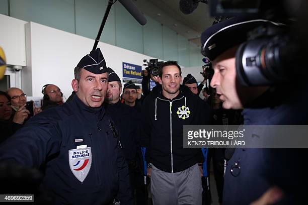 French pole vaulter Renaud Lavillenie walks on crutches as he arrives at Charles de Gaulle Airport in RoissyenFrance near Paris on February 16 2014...