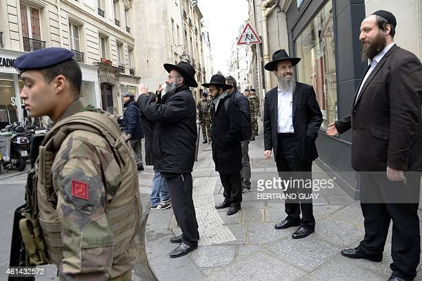 French police and army patrol on January 12 2015 in the Rue des Rosiers in the Jewish quarter of the Marais district in Paris France announced an...