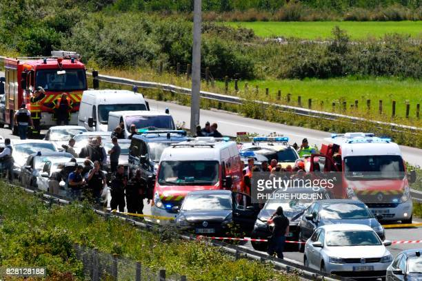 French police and emergency workers intervene on the site after the police arrested a suspect on the A16 motorway near Marquise northern France on...