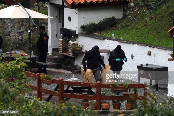 French police are seen following a raid on the Orerreka gite or holiday cottage between SaintEtiennedeBaigorry and Banca south western France on...