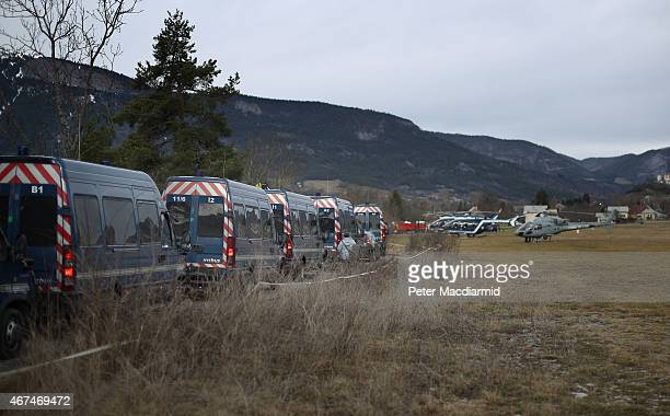 French police arrive at a field where police and military helicopters have landed on March 25 2015 in Seyne France Germanwings flight 4U9525 from...