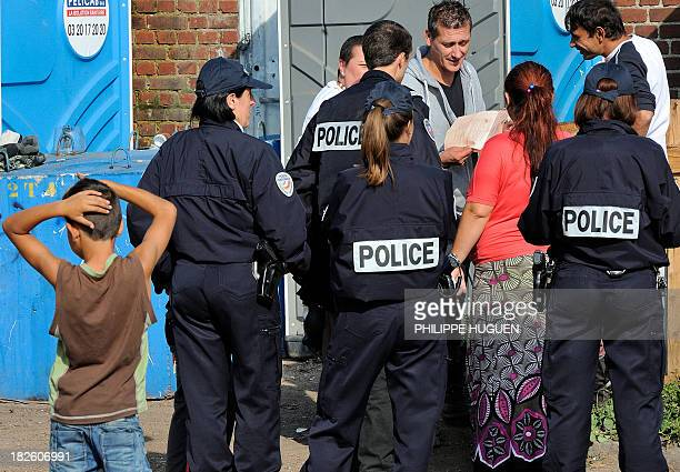 French police as carry out identity checks at a Roma camp on October 1 2013 in Roubaix northern France French Minister Manuel Valls has been publicly...
