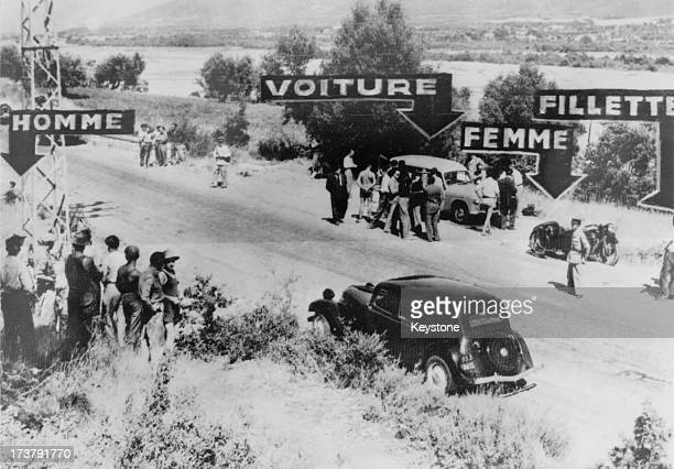 French police at the scene of the murders of British biochemist Sir Jack Drummond his wife Anne and their 10 yearold daughter Elizabeth on a road...