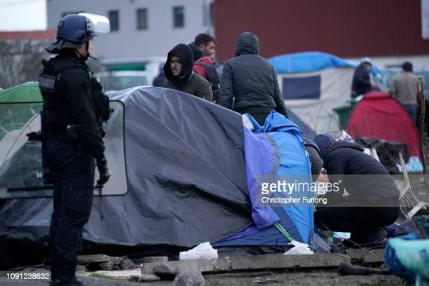 French police clear a migrant camp near Calais Port on January 08 2019 in Calais France In recent weeks there has been an increase in migrants many...