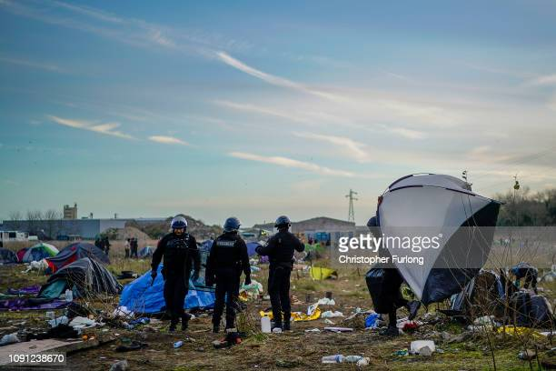 French police clear a migrant camp near Calais Port on January 08, 2019 in Calais, France. In recent weeks there has been an increase in migrants,...