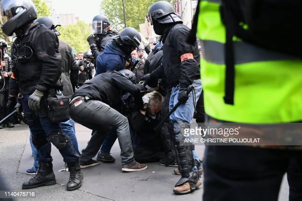French police detain a protester during clashes on the sidelines of the annual May Day workers' rally in Paris on May 1 2019