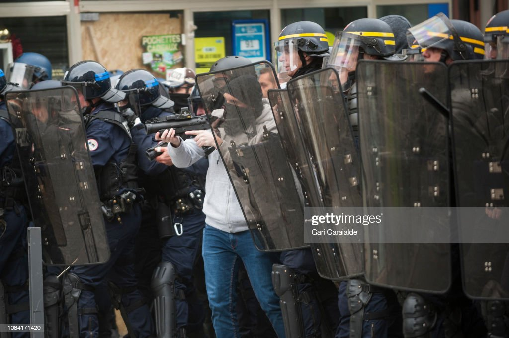 French police during a visit by french foreign minister jean yves