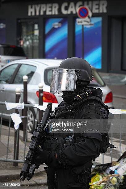 French Police elite RAID secure the area while Benjamin Netanyahu Prime Minister of Israel pays his respects at the Hyper Cacher following the recent...