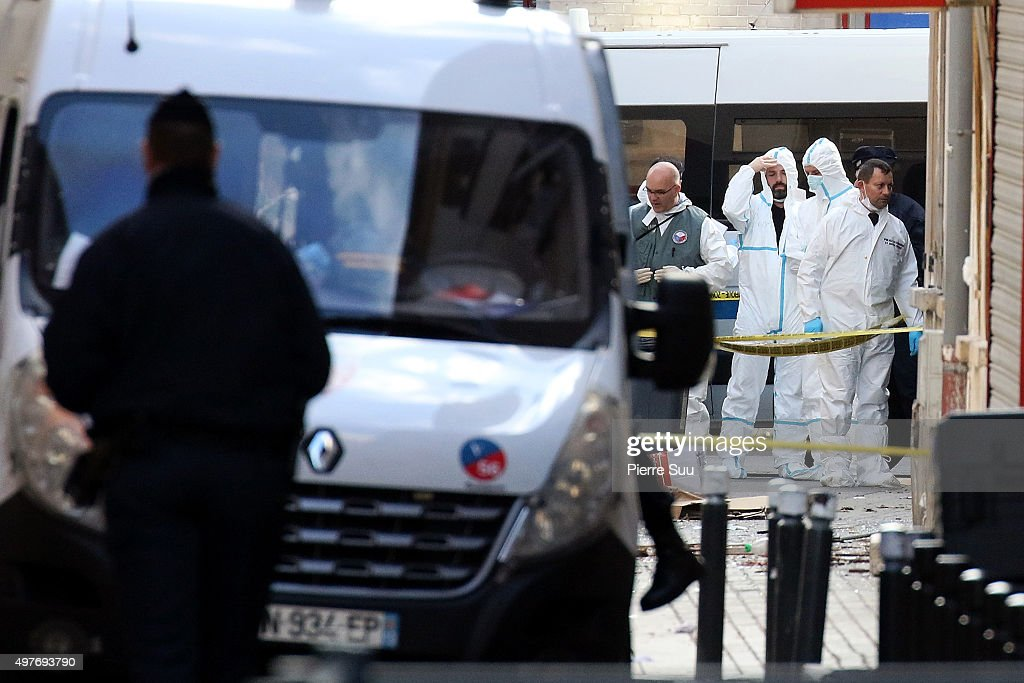 French Police Forensics officers work on Rue des Corbillon in the northern Paris suburb of Saint-Denis following a raid on an apartment on November 18, 2015 in Saint-Denis, France. French Police special forces raided an apartment, hunting those behind the attacks that claimed 129 lives in the French capital five days ago. At least one person was killed in an apartment targeted during the operation aimed at the suspected mastermind of the attacks, Belgian Abdelhamid Abaaoud. At least five police officers have been wounded in the shootout.