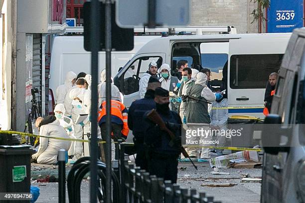 French Police Forensics officers work on Rue des Corbillon in the northern Paris suburb of Saint-Denis following a raid on an apartment on November...
